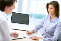 A consultant talking to a client